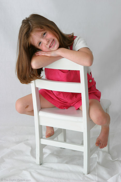 Cute Girl on White Chair Picture