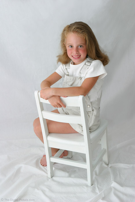 Girl Posed on Chair Picture