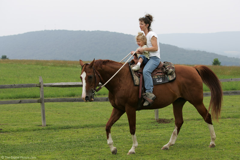 Mother and Daughter Horseback Riding Picture