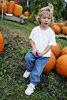 Girl Sitting on Pumpkin Picture