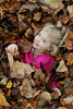 Girl in Leaf Pile Picture