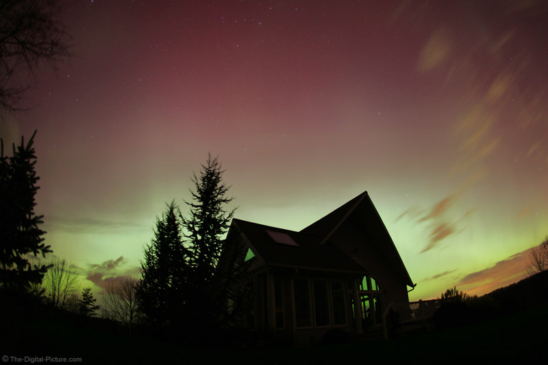 House Backlit By Northern Lights