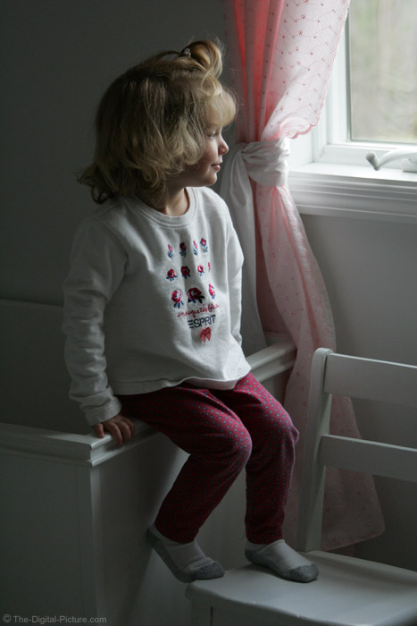 Little Girl Looking Out Window Picture