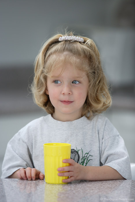 Little Girl With a Yellow Cup