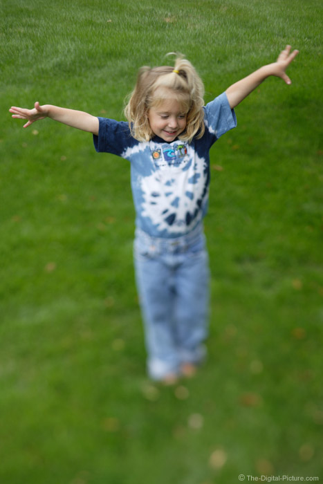 Young Girl with Her Arms in the Air Picture