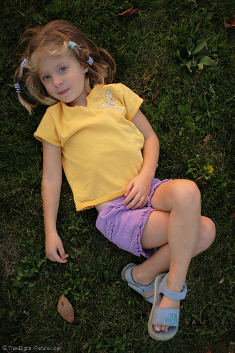 Girl Resting in Grass Picture