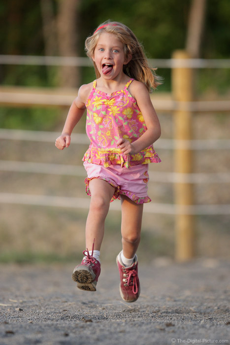 Girl Running with Tongue Out Picture