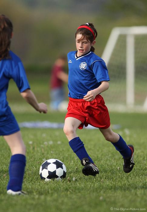 Soccer Player Meets Defender