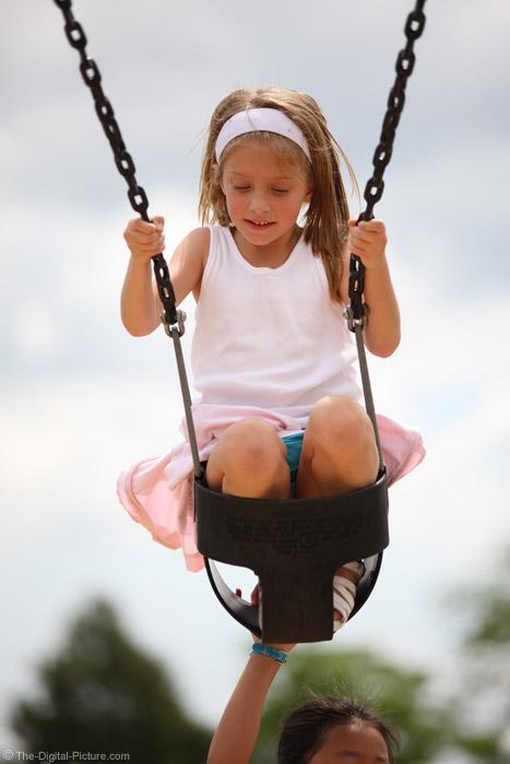 Girl Taking Swing Ride