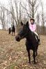 Girls and Alert Horses