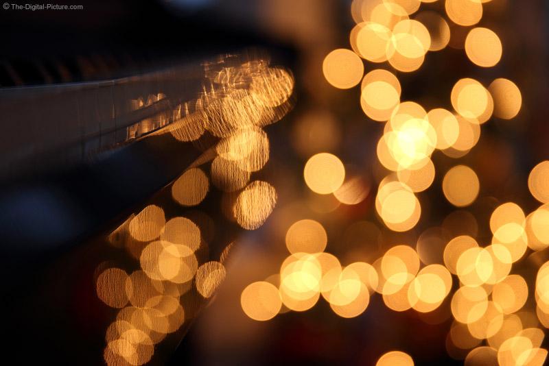 Christmas Lights Reflecting on Piano