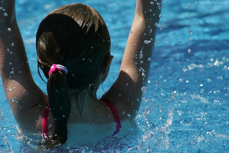 Girl Splashing in Pool Picture