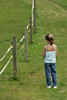 Girl Standing Beside Fence Picture