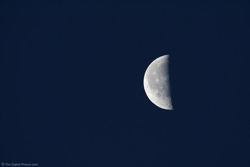 Half Moon Against Dark Blue Sky Picture