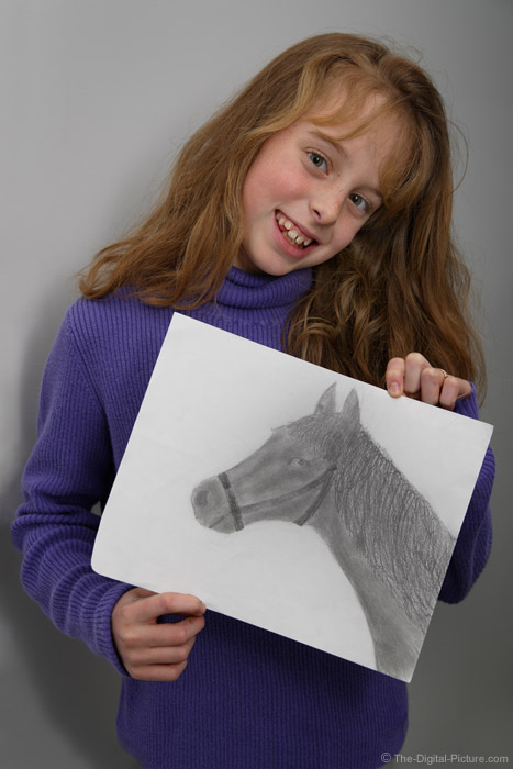 A Girl with Her Pencil Drawing