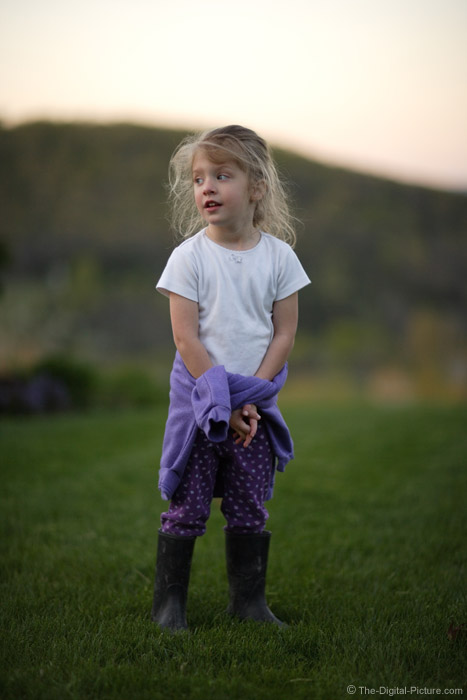 Little Girl Standing in the Yard