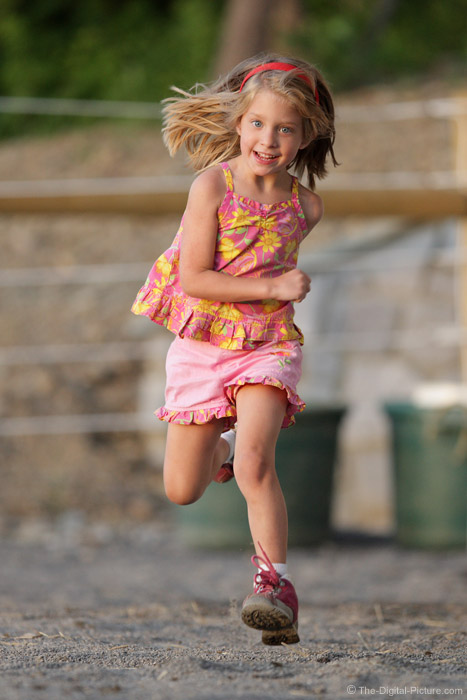Girl Running with a Big Smile Picture