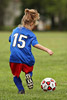 Girl Chasing Soccer Ball Picture