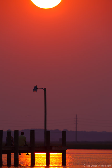 Couple on Dock Watching Sunset