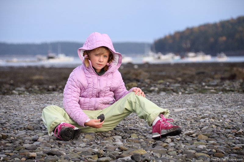Tired Girl on the Rocks Picture