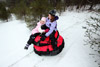 Two Girls on Two Snow Tubes