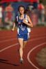 Mid-Distance Runner Caught Mid-Stride
