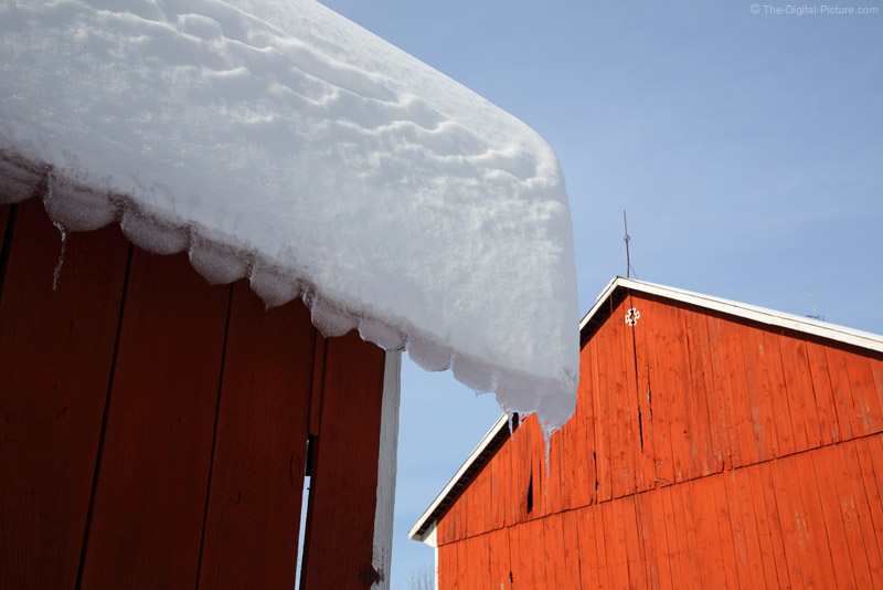 Snow and Old Red Barns